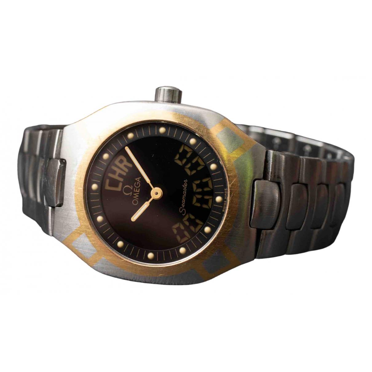 Omega - Montre   pour femme en or et acier - dore