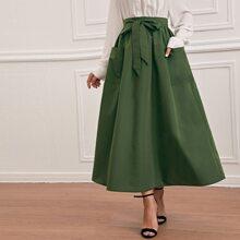 Falda con cinturon con bolsillo unicolor