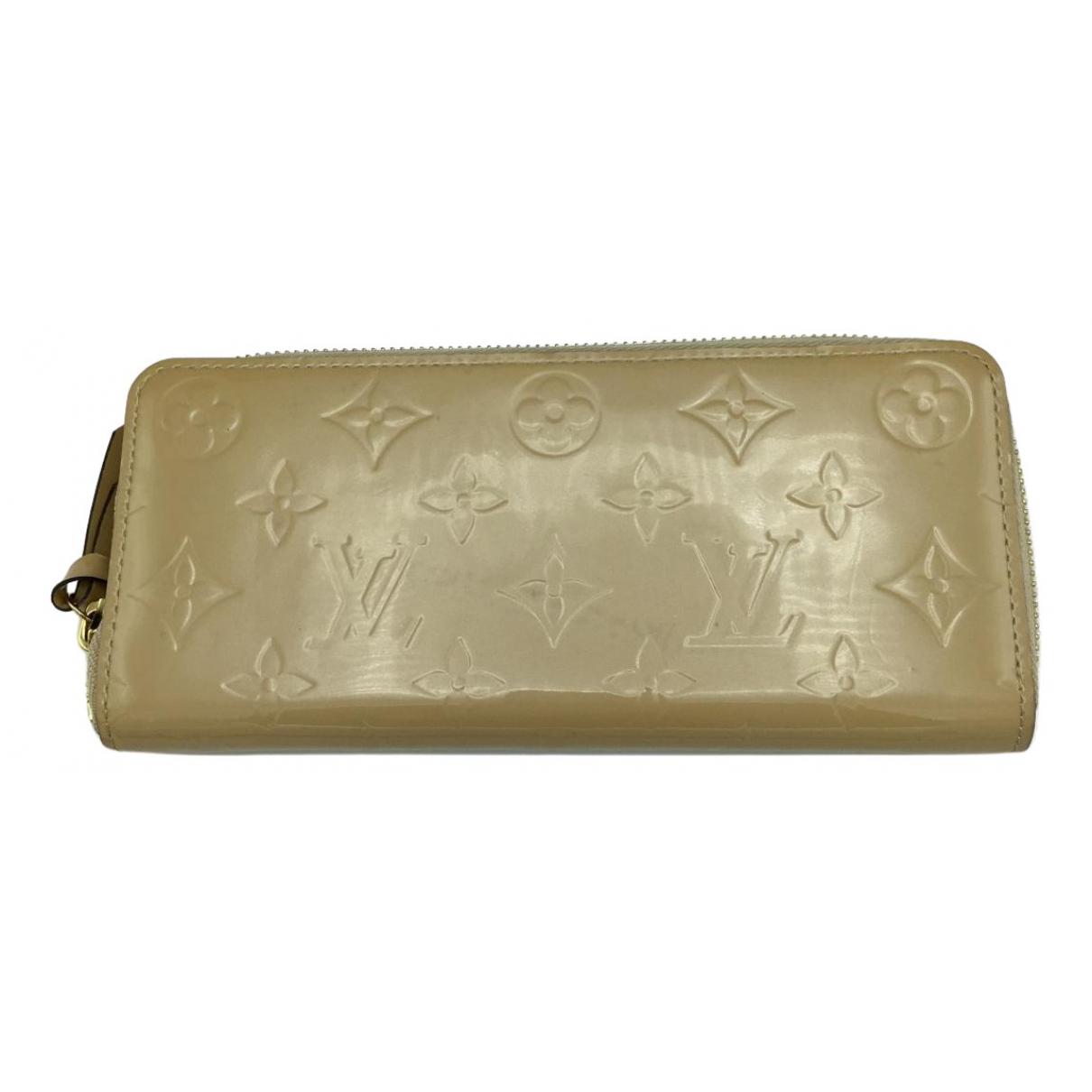 Louis Vuitton - Portefeuille Clemence pour femme en cuir verni - dore