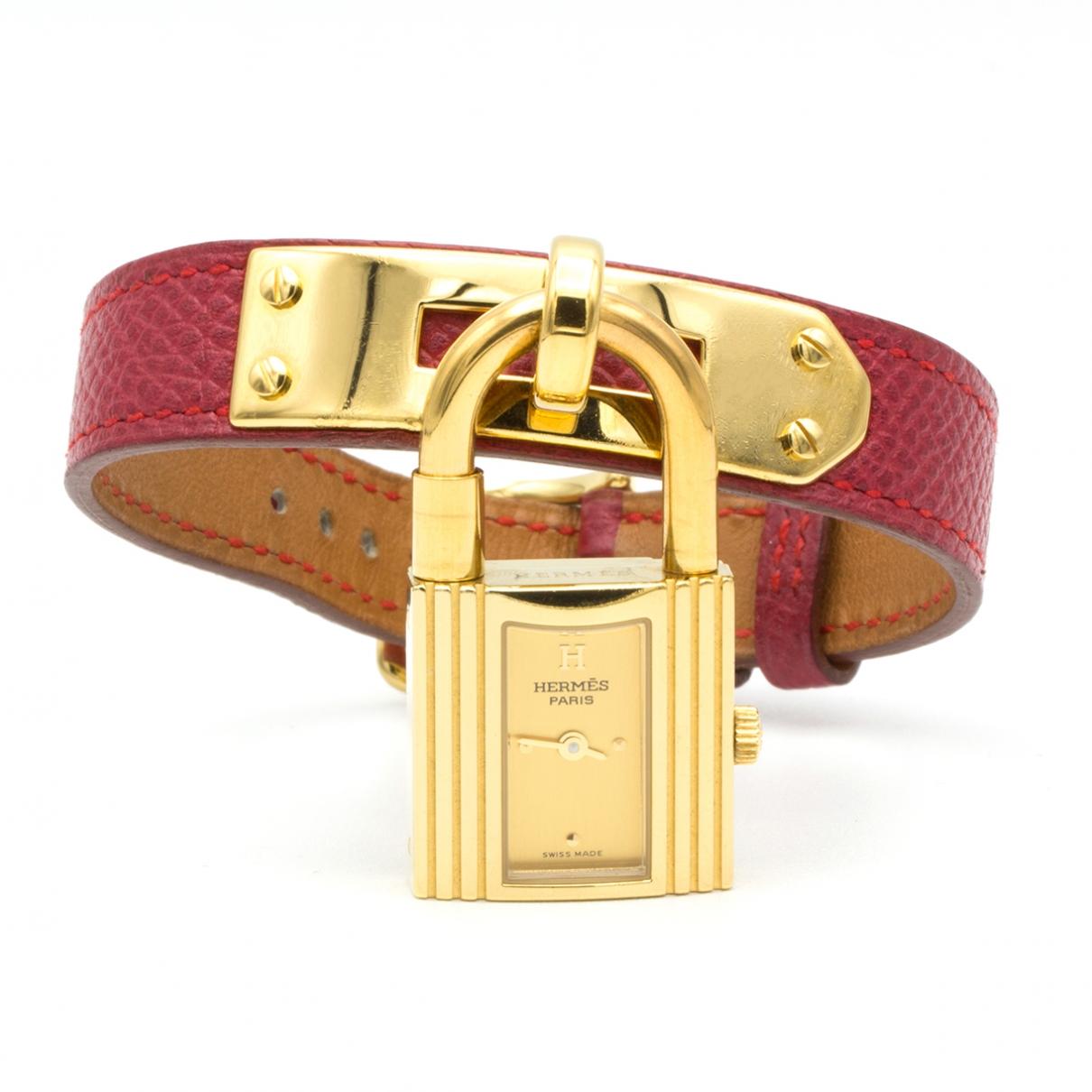 Hermes - Montre Kelly pour femme en plaque or - rouge