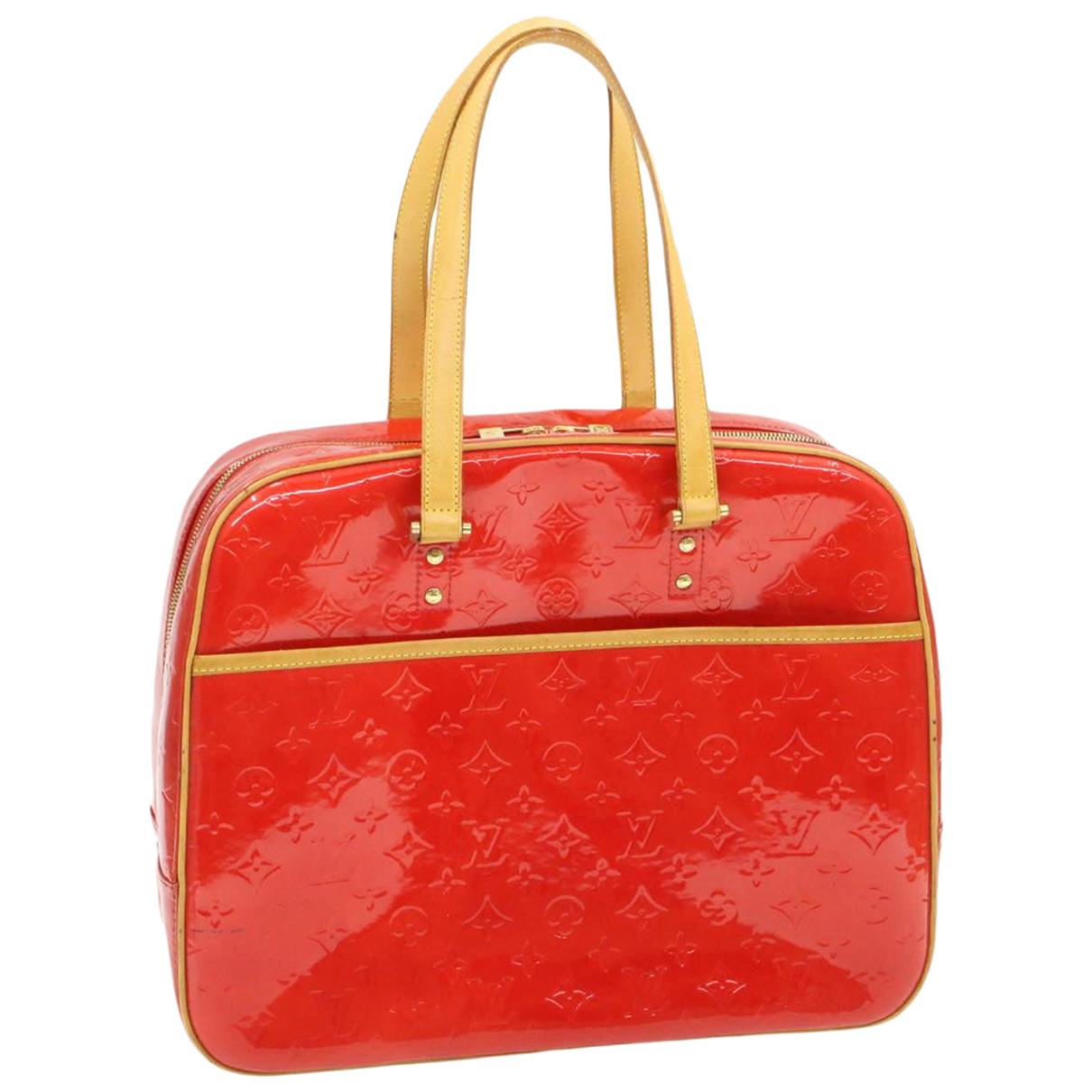 Louis Vuitton - Sac a main   pour femme en cuir verni - rouge