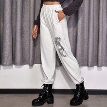 Hose mit chinesischer Drache Grafik und schraegen Taschen