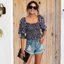 Camisa peplum fruncido con estampado de leopardo