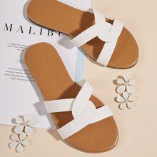 Sandalen mit Twist