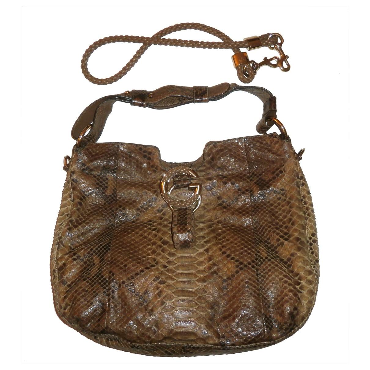 Gucci \N Handtasche in  Braun Python