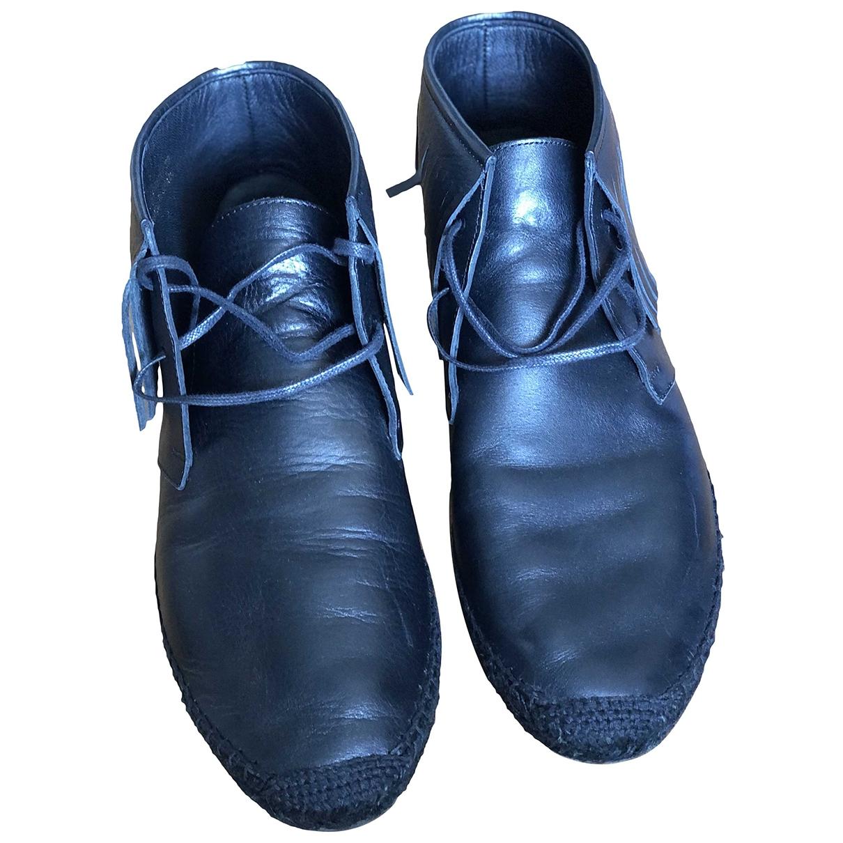 Saint Laurent - Boots   pour femme en fourrure - noir