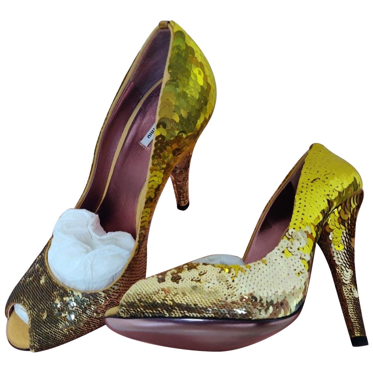Miu Miu \N Yellow Glitter Heels for Women 38 EU