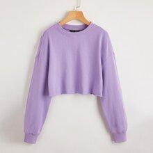 Einfarbiger Crop Pullover mit sehr tief angesetzter Schulterpartie