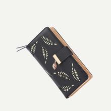 Monedero doblado con diseño de hoja