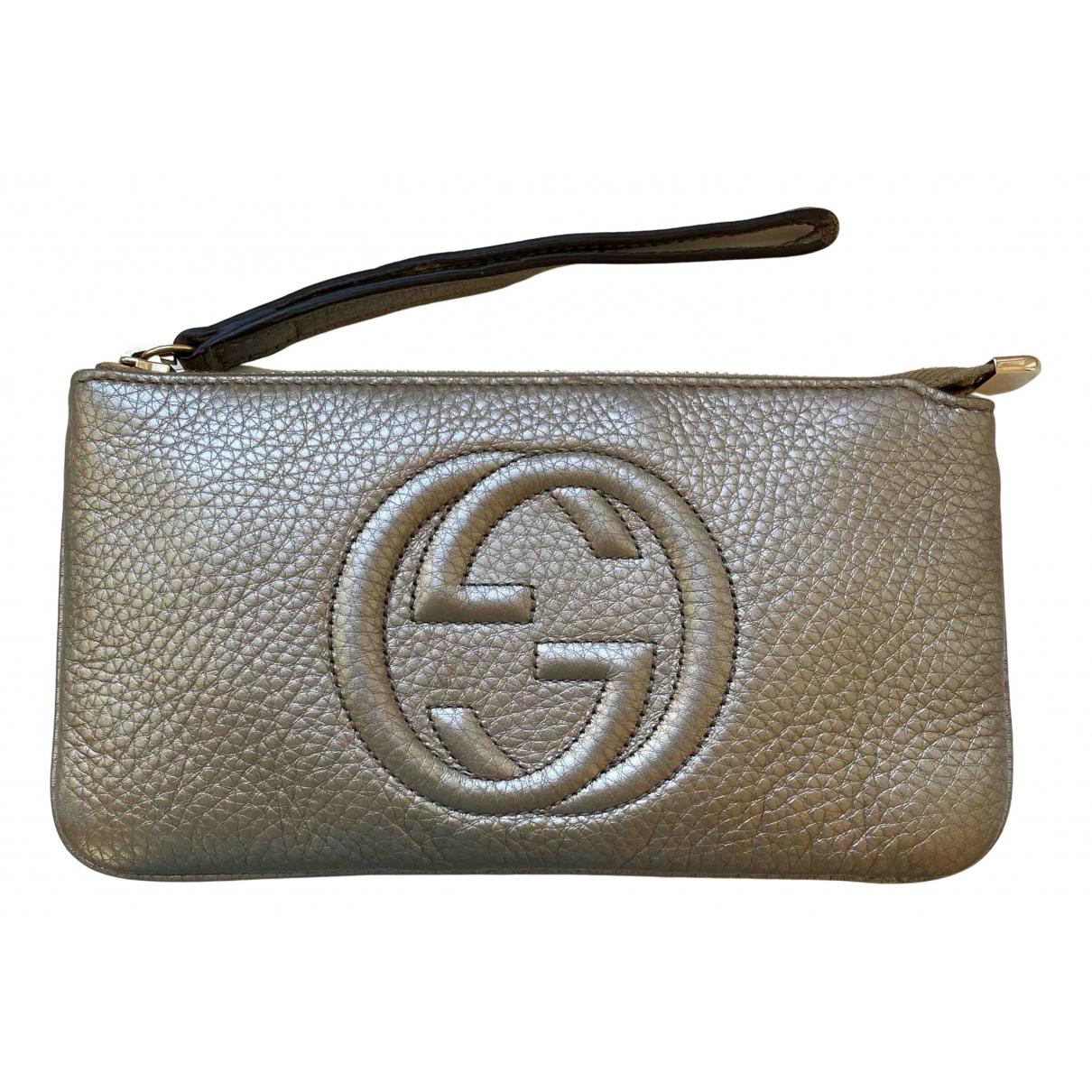 Gucci - Pochette Soho pour femme en cuir - dore