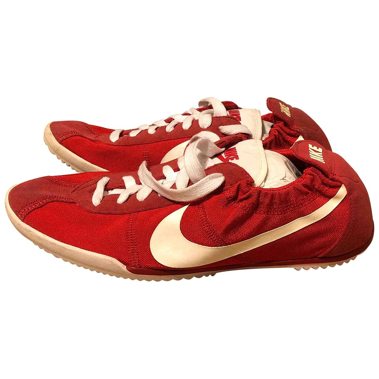 Nike - Baskets   pour femme en toile - rouge