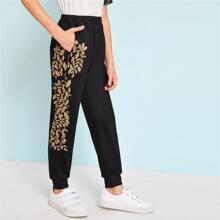 Pantalones deportivos de niños con bolsillo oblicuo con estampado de hoja