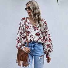 Bluse mit Blumen Muster und Knopfen
