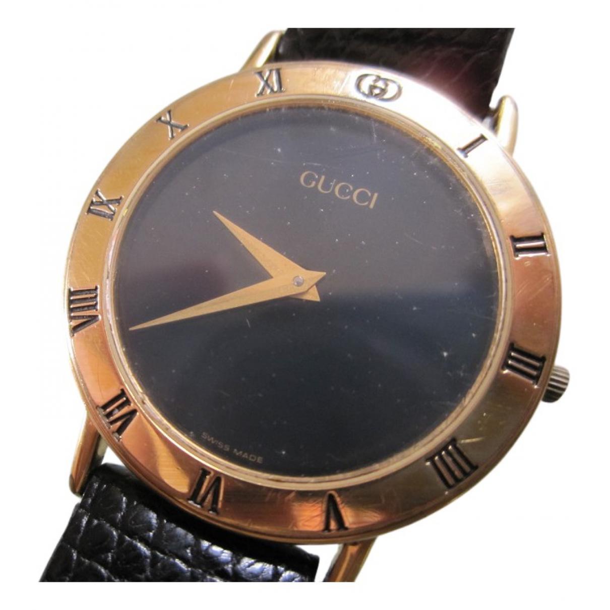 Gucci - Montre   pour homme en plaque or - dore