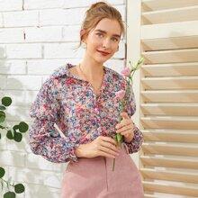 Camisa con boton con estampado floral