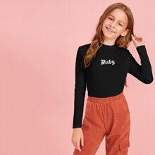 Camiseta de niñas con letra y dibujo tejida de canale de cuello alto