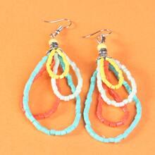 Mehrschichtige Ohrringe mit Perlen