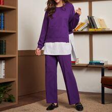 Conjunto pullover de rayas con pantalones