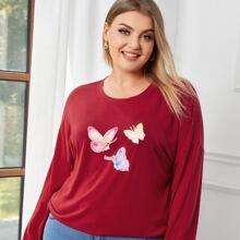T-Shirt mit sehr tief angesetzter Schulterpartie und Schmetterling Muster