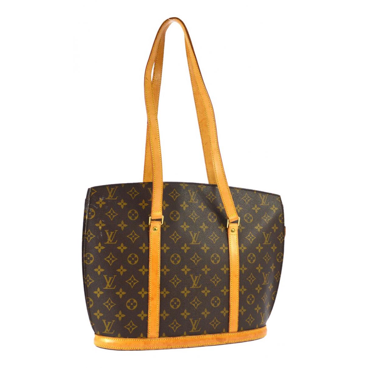 Louis Vuitton - Sac a main Babylone vintage pour femme en toile - marron