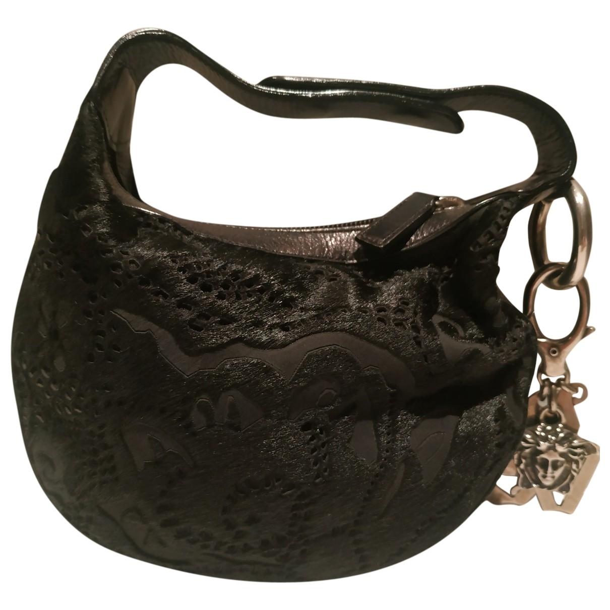 Versace \N Handtasche in  Schwarz Kalbsleder in Pony-Optik
