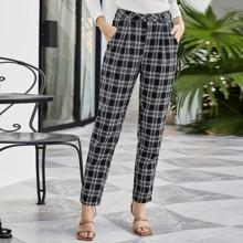 Konische Hose mit Plaid Muster und schraegen Taschen