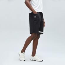 Shorts deportivos con estampado de letra