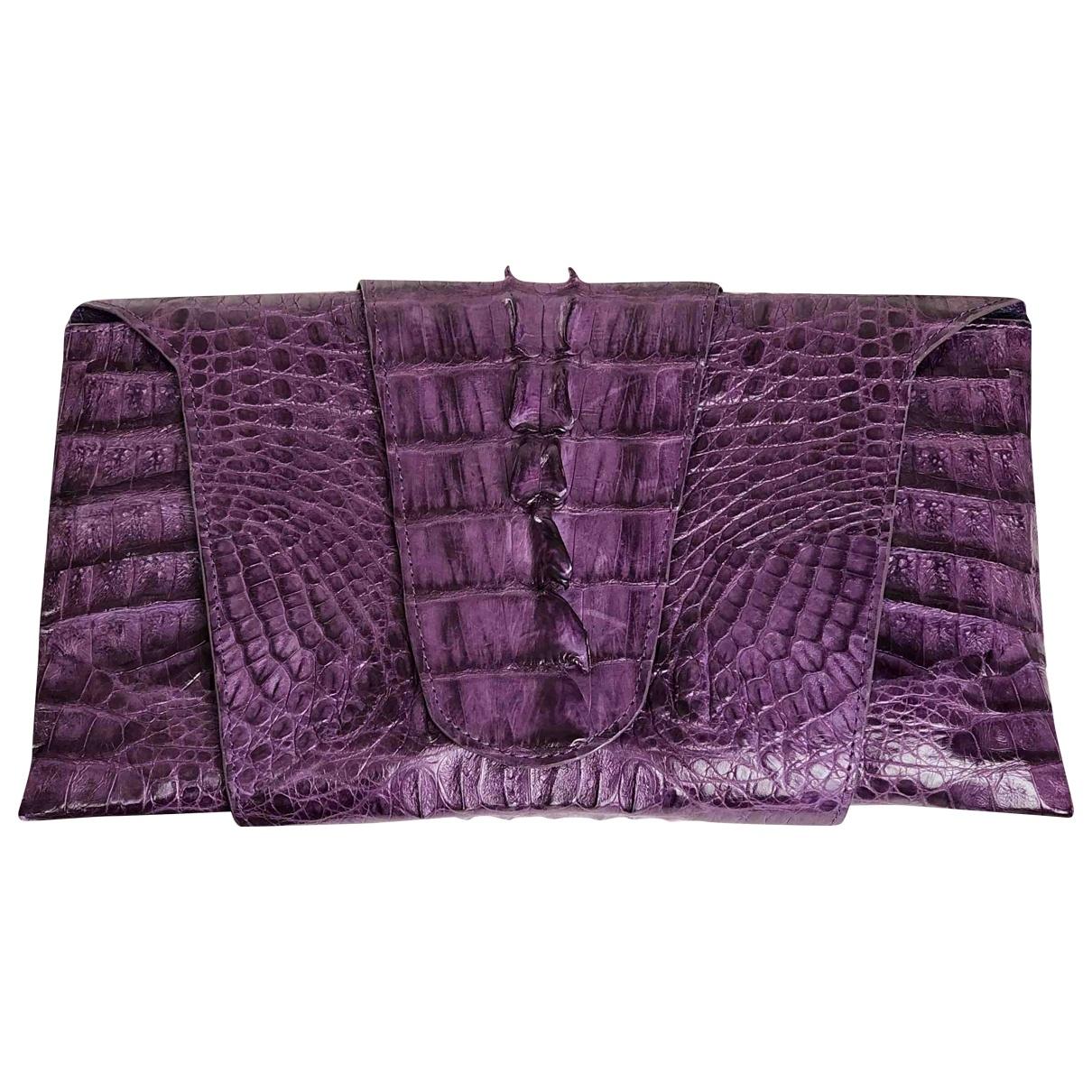 Non Signé / Unsigned \N Purple Crocodile Clutch bag for Women \N