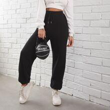 Pantalones deportivos con estampado de slogan de cintura con cordon