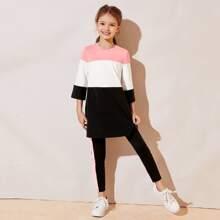 Conjunto top largo de color combinado con leggings con costura lateral en contraste