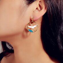 Ohrringe mit Lochern und Vogel Dekor