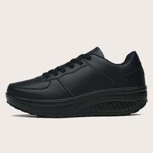Minimalistische Sneakers mit Band vorn und klobiger Sohle