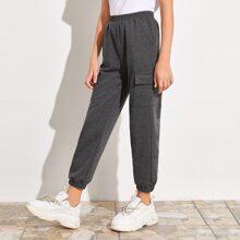Pantalones deportivos con bolsillo con solapa