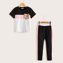 Conjunto de niñas top de color combinado con bolsillo con lentejuelas con pantalones de lado de rayas