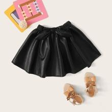 Falda de niñitas amplia de cuero de pelo sintetico con lazo delantero
