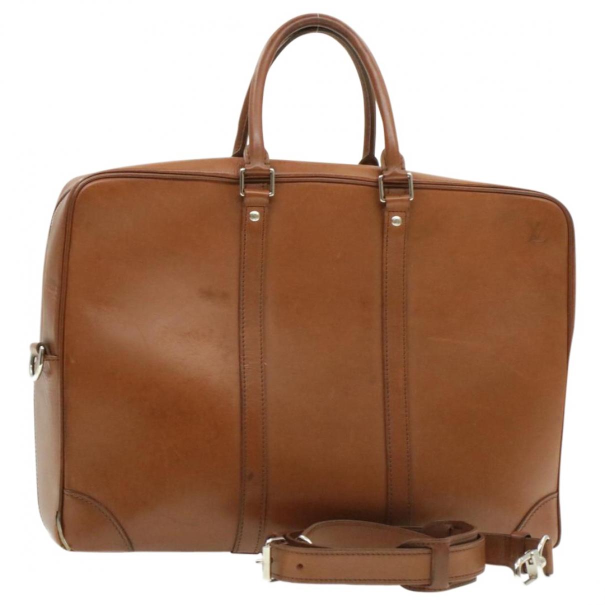 Louis Vuitton - Sac a main Porte Documents Voyage pour femme en cuir - marron