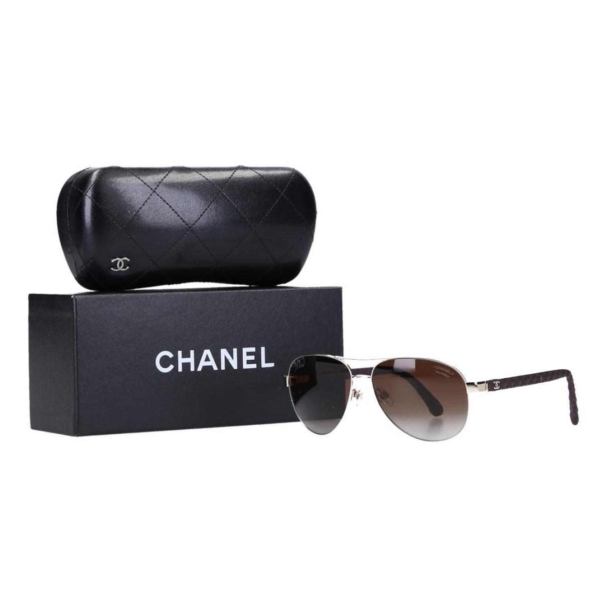 Chanel \N Sonnenbrillen in  Braun Metall