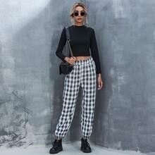 Pantalones conicos con bolsillos oblicuos de cuadros