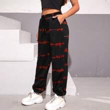 Hose mit schraegen Taschen und Batik