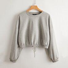 Crop Pullover mit sehr tief angesetzter Schulterpartie und Kordelzug am Saum
