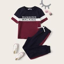 Conjunto de niñas top de color combinado con estampado de letra con pantalones deportivos con costura lateral