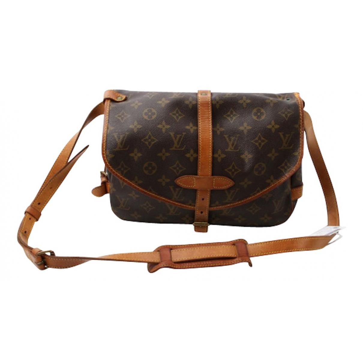 Louis Vuitton - Sac de voyage Saumur pour femme en cuir - marron