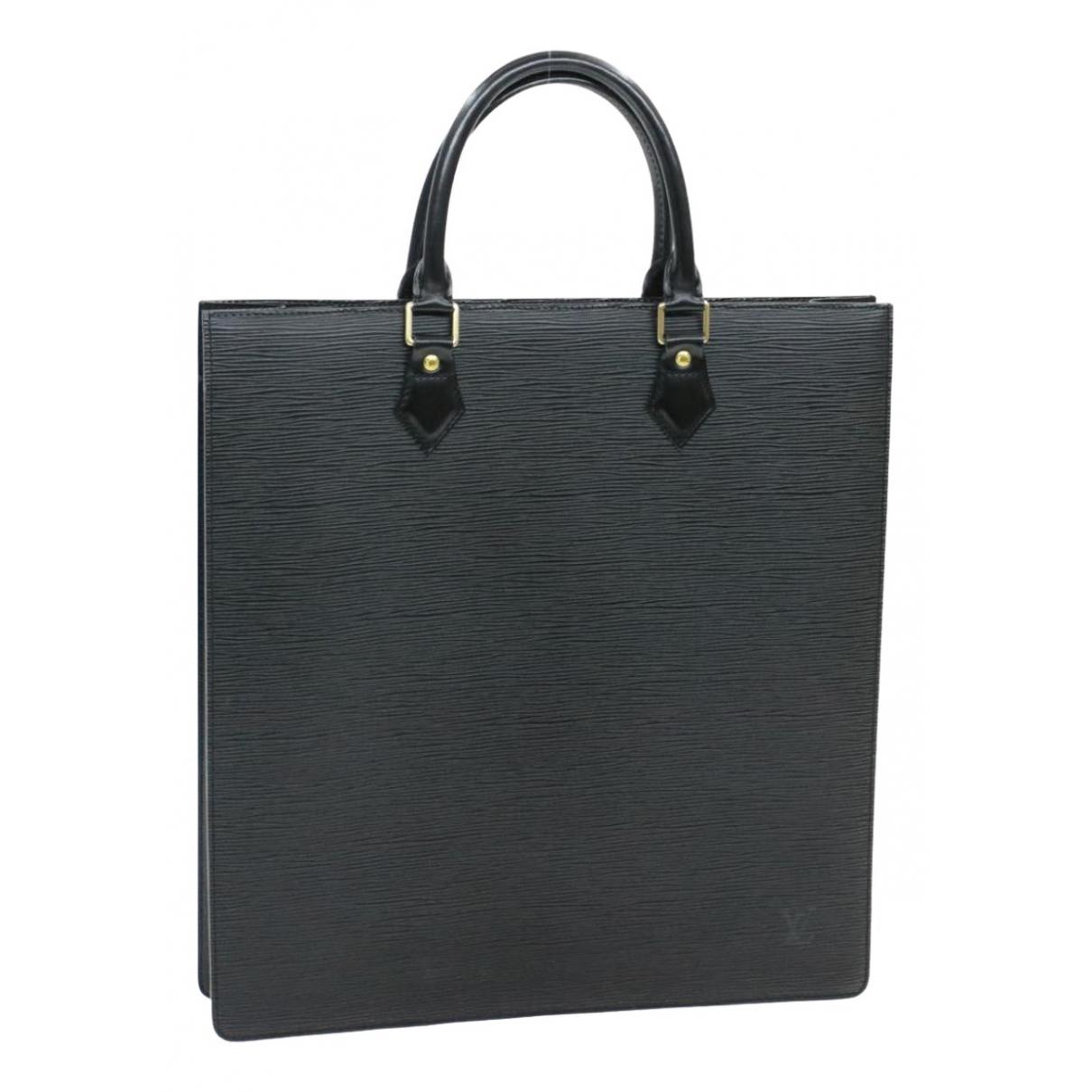 Louis Vuitton - Sac a main Plat pour femme en cuir - noir