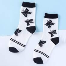 Socken mit Schmetterling Muster