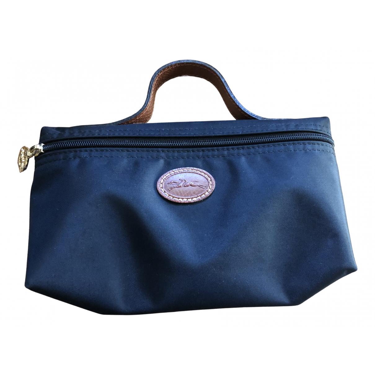 Longchamp - Pochette   pour femme en cuir - noir