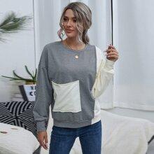 Pullover mit sehr tief angesetzter Schulterpartie, Taschen vorn und Farbblock