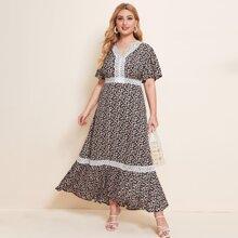 Kleid mit Guipure Spitzen und Gaensebluemchen Muster