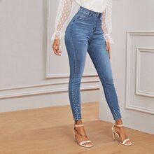 Schmale Jeans mit Perlen, umgesaeumtem Saum und Waesche