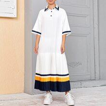 Kleid mit Knopfen, Falten und Farbblock