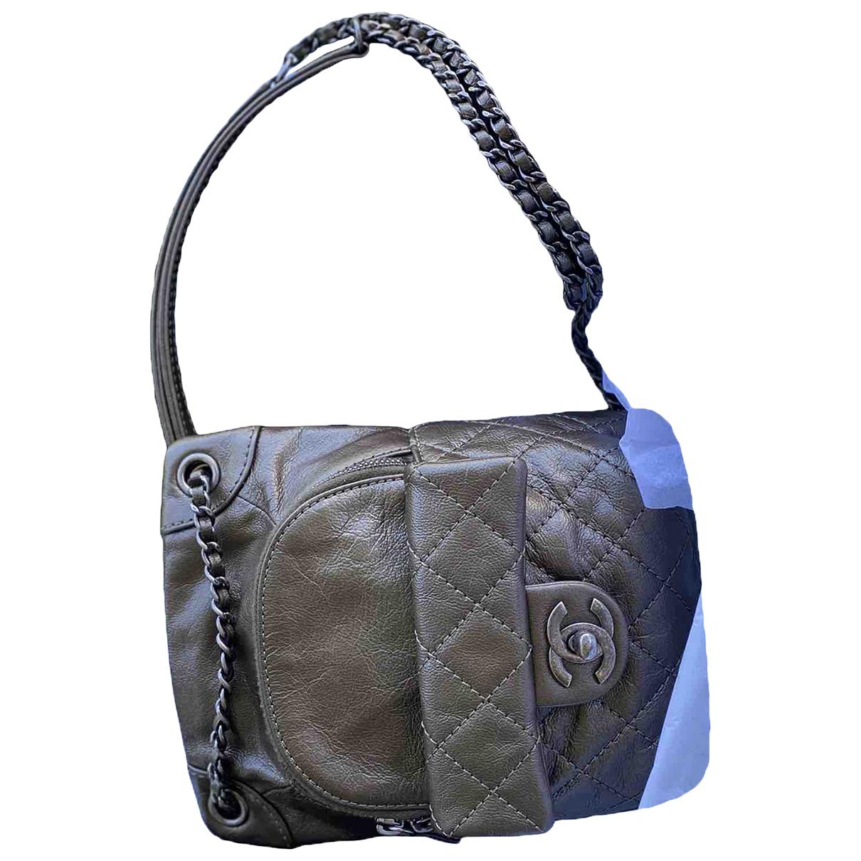 Chanel - Sac a dos   pour femme en cuir - kaki